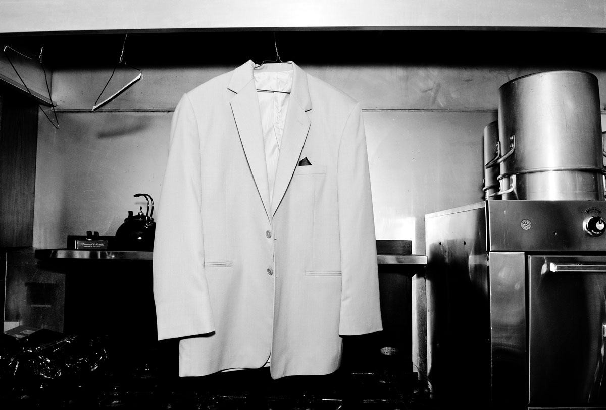 groom-getting-ready-suit-black-and-white